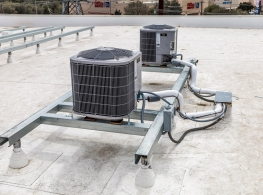 Universal bracket system for mounting AC condensers on a flat commercial roof.