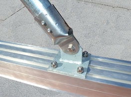 DryCap™ aluminum sleeper cap cover for making commercial roof sleepers watertight.
