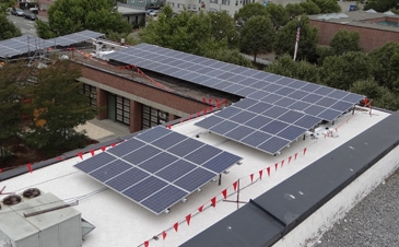 Solar racking on asphalt and gravel roof