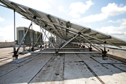 Large truss elevated solar racking system by Silverback Solar.
