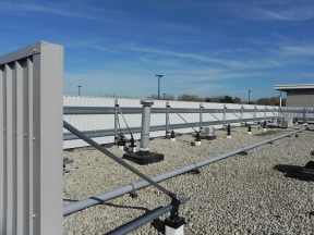 RoofScreen equipment screen system solves problems associated with other equipment screen methods