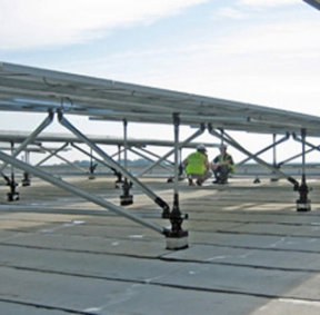 Solar racking elevated above sloping roof deck